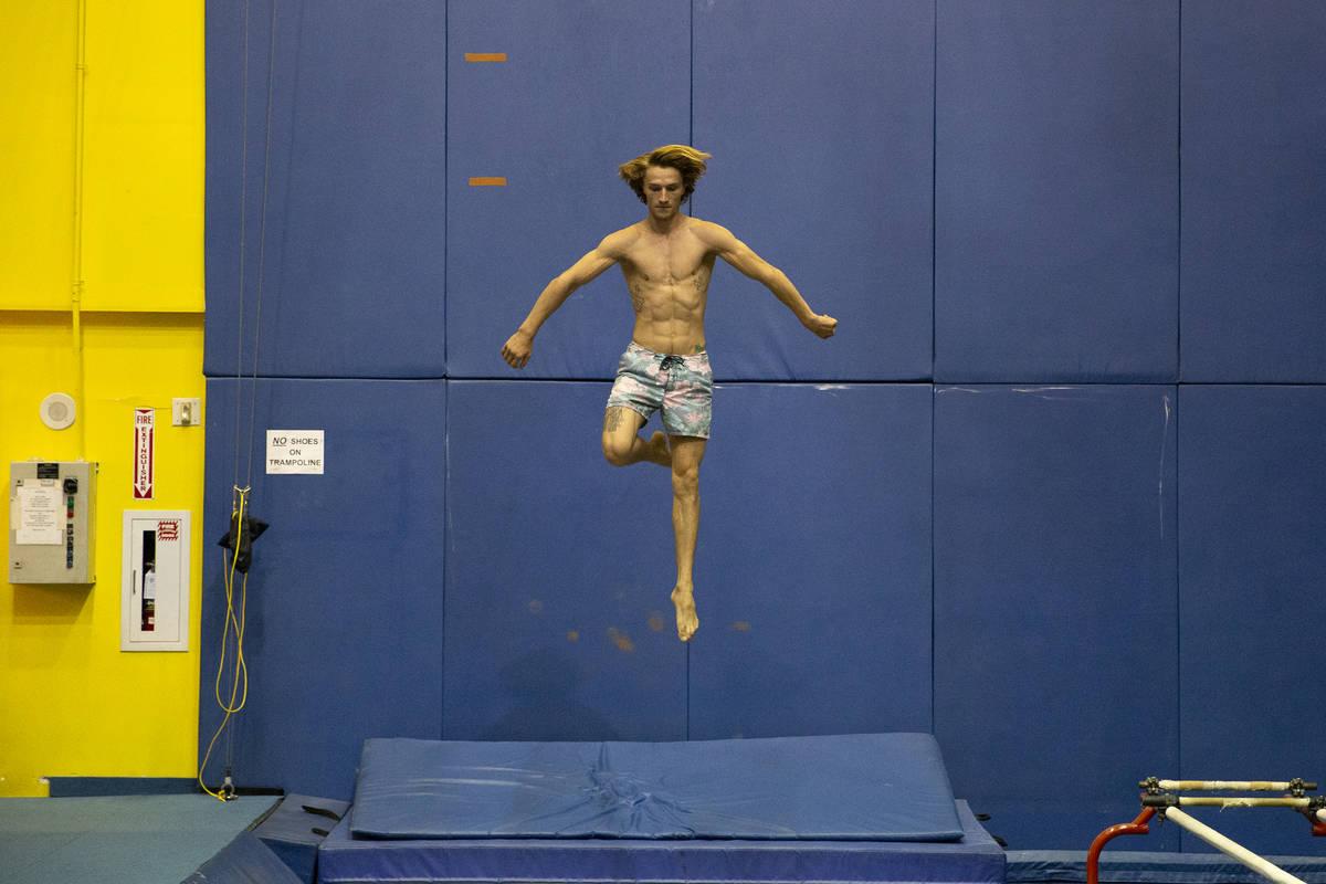 "Cirque du Soleil artist Ryan Mitchell trains whlie a rehearsal for ""O"" is underway in ..."