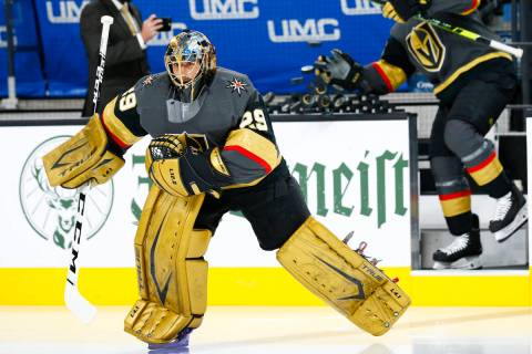 Golden Knights goaltender Marc-Andre Fleury warms up before the start of Game 5 of a first-roun ...