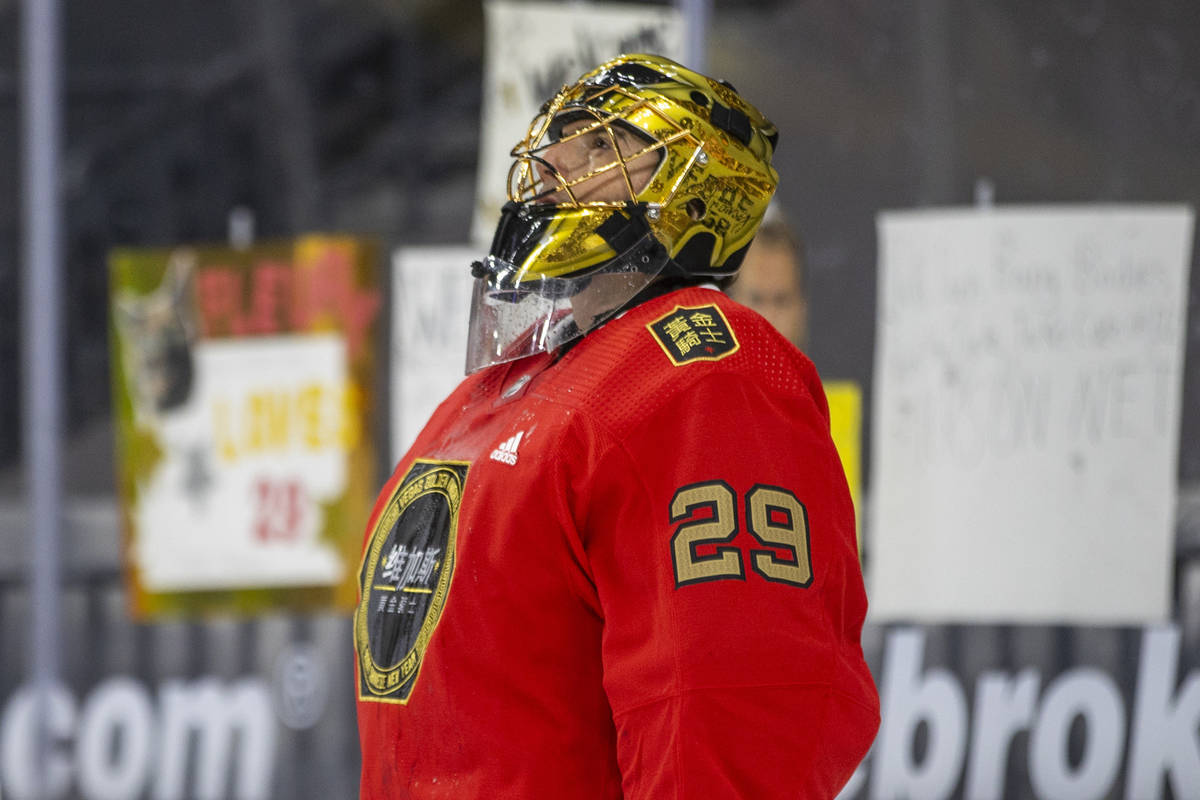 Golden Knights goaltender Marc-Andre Fleury (29) looks up during warm ups before the first peri ...