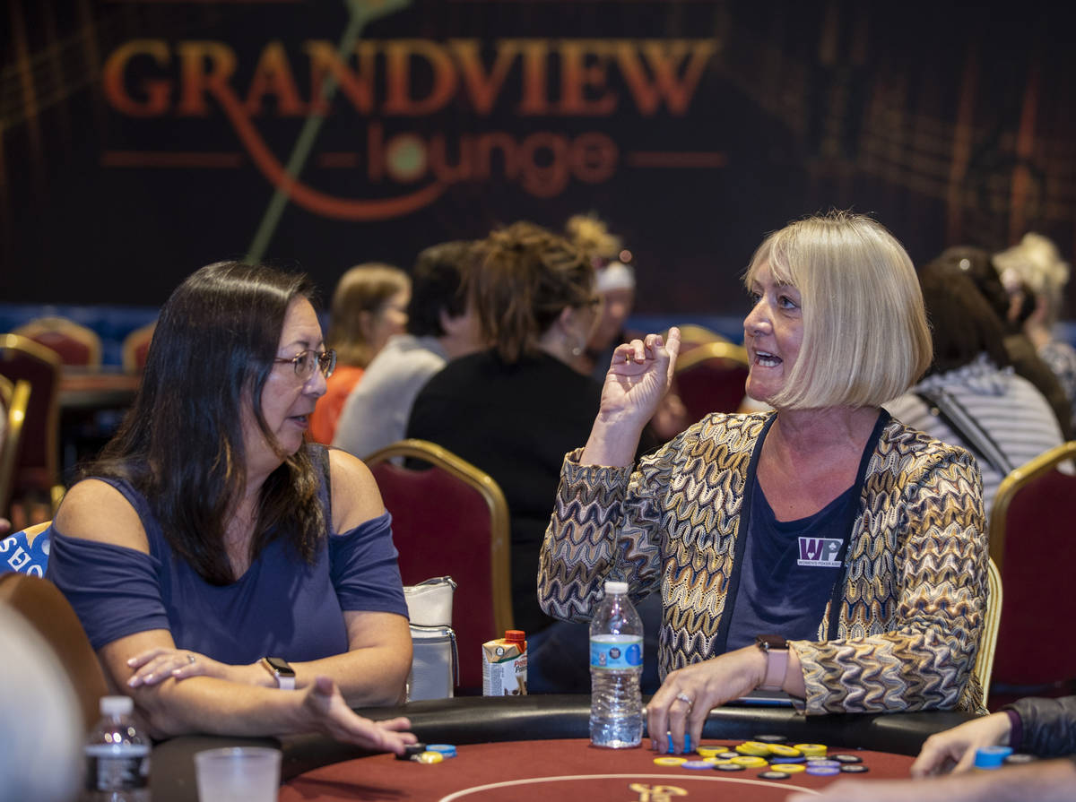 Players Julie Herbert , left, and Vera Murillo talk in between hands as they compete in the $35 ...