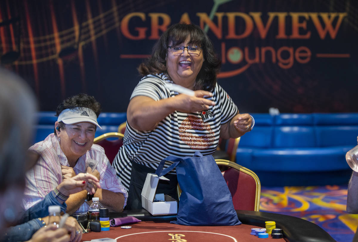 Ladies International Poker Series (LIPS) founder Lupe Soto tosses free merchandise to players d ...