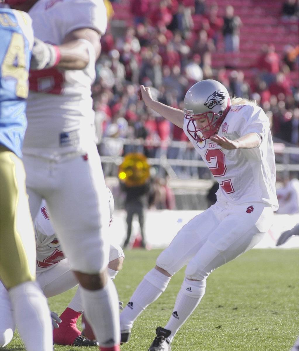 Katie Hnida, a place-kicker for New Mexico, attempts an extra point during the first quarter We ...