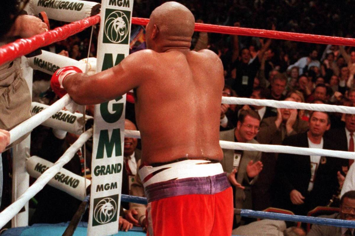 George Foreman kneels and prays after knocking out Michael Moorer in the 10th round on Nov. 5, ...