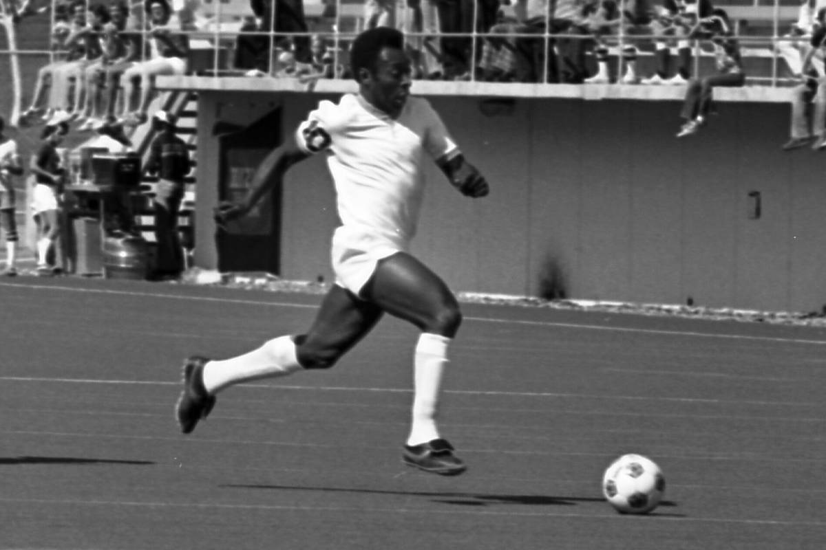Pele leads the New York Cosmos against the Las Vegas Quicksilvers at what was then known as Las ...