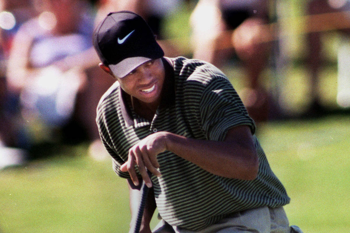 Tiger Woods defeated Davis Love III on the first hole of a sudden death playoff to notch the fi ...