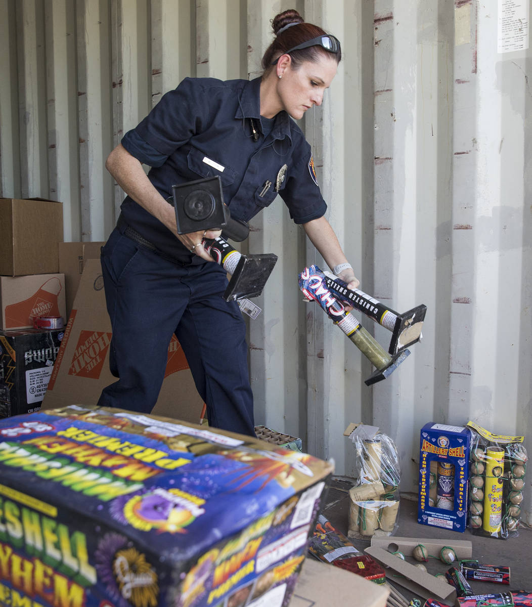 Amanda Wildermuth, with Clark County Fire Prevention, organizes confiscated illegal fireworks t ...