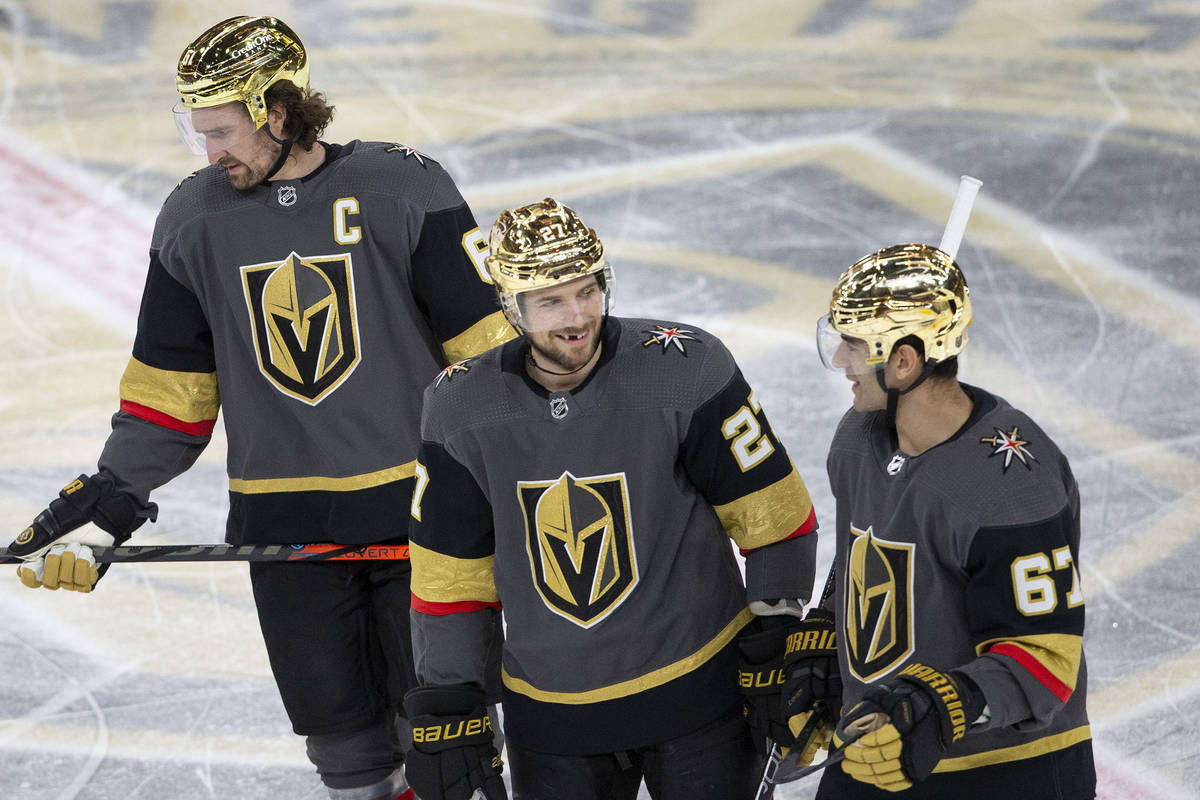 Golden Knights defenseman Shea Theodore (27) communicates with Golden Knights right wing Mark S ...