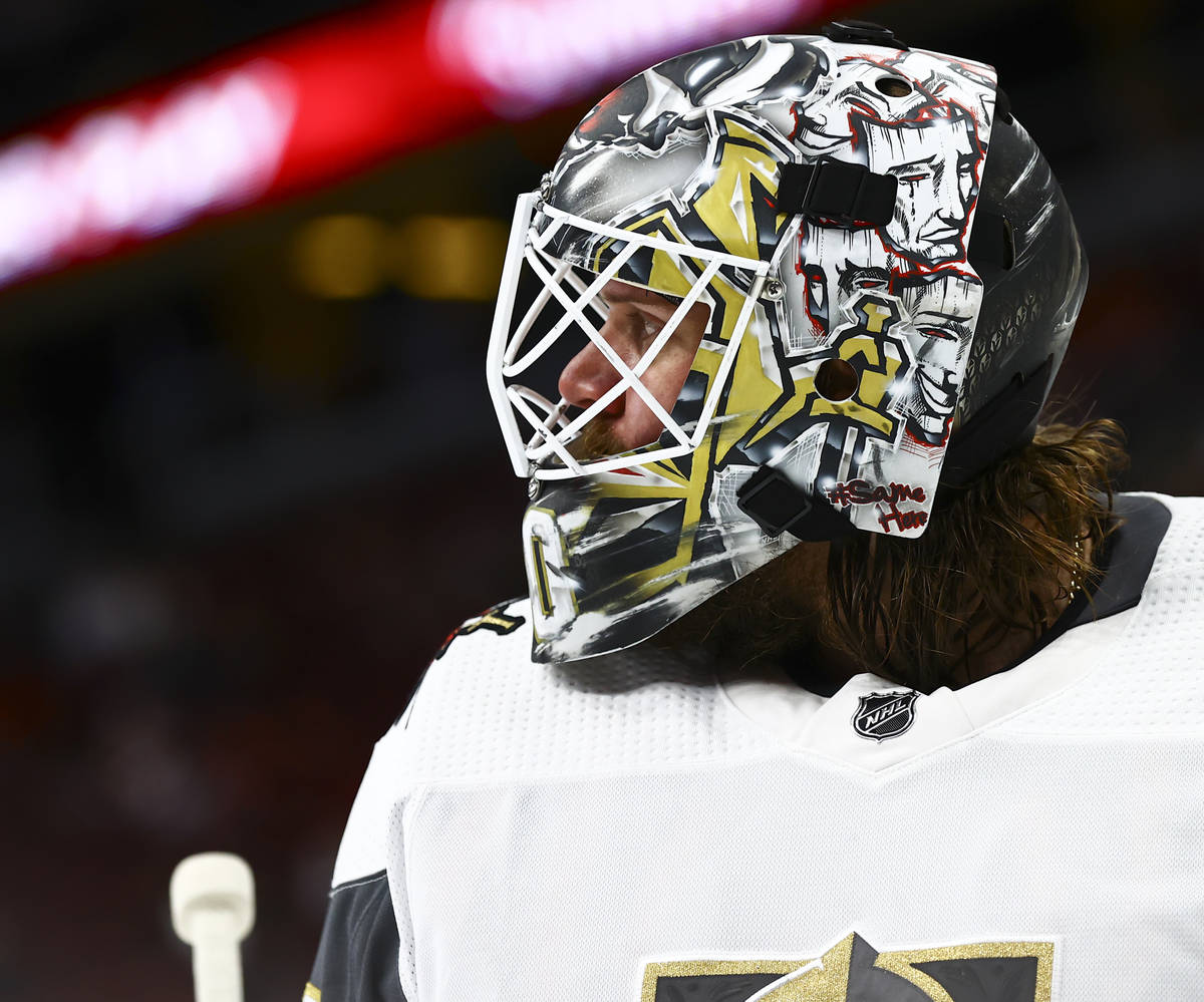 Golden Knights goaltender Robin Lehner (90) looks on during a break the second period of an NHL ...