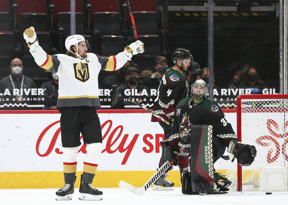 Golden Knights' Mark Stone (61) celebrates after an overtime win against the Arizona Coyotes in ...