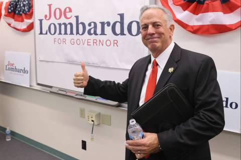 Clark County Sheriff Joe Lombardo poses with his campaign sign after announcing his candidacy f ...