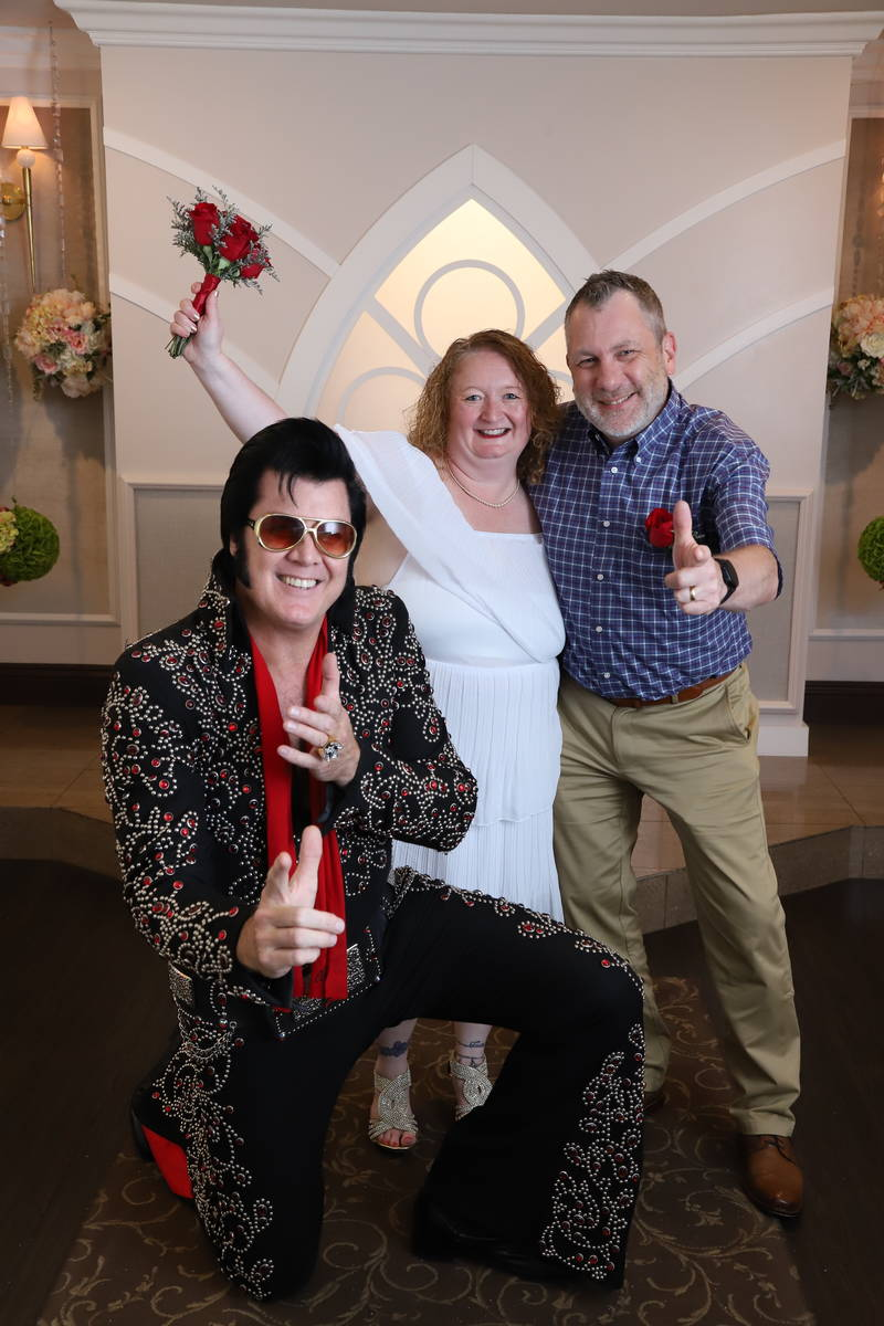 New Yorkers Cindy and Don Couse celebrate, along with chapel co-owner and Elvis impersonator Br ...