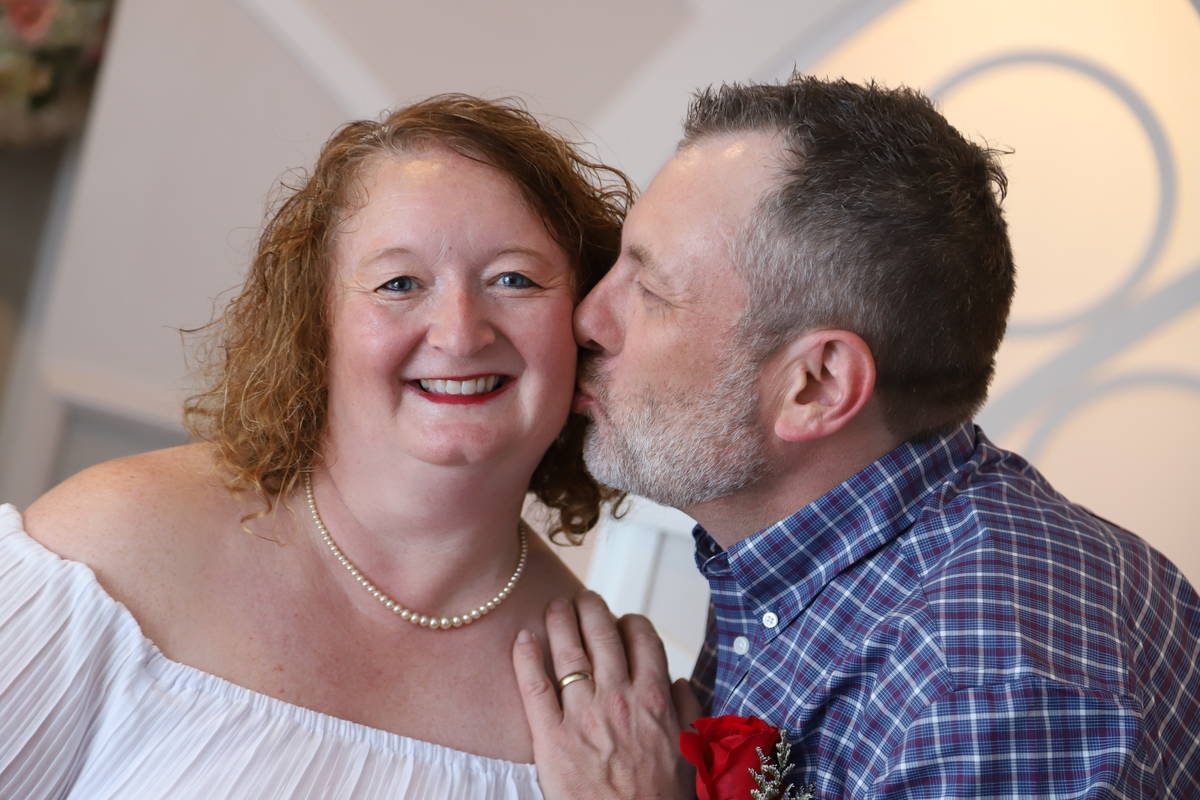 Don Couse gives his wife, Cindy, a kiss on the cheek after the couple renewed their vows at Gra ...