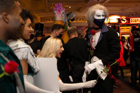 """Cast members of """"O"""" walk through Bellagio in a welcome back parade on Thursday, July ..."""