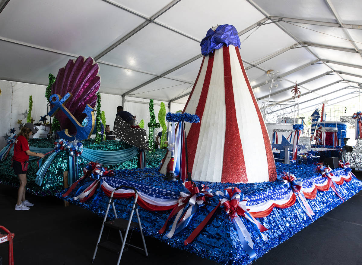 "Elizabeth Engle, a volunteer, decorates ""Undersea Jubilee"" float for the July 4th Summerlin Cou ..."