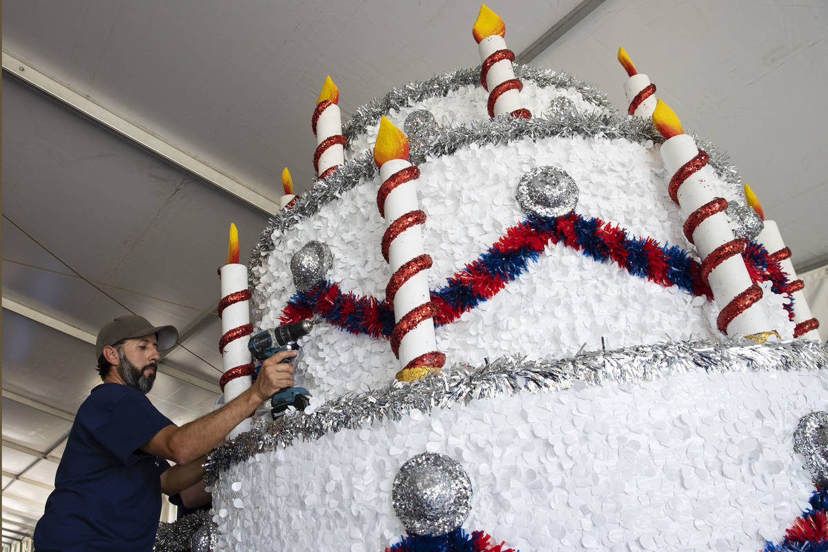 """David Bailey, Summerlin Council employee, decorates """"Viva Las Vegas"""" float for the July 4th Sum ..."""