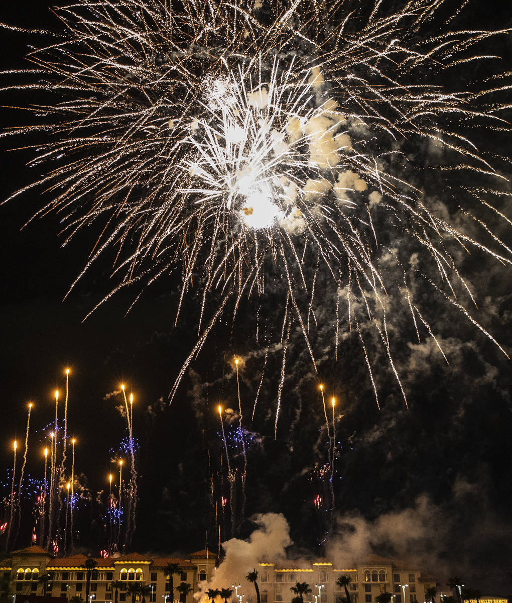 Fireworks go off above the Green Valley Ranch, on Sunday, July 4, 2021, in Henderson. (Bizuayeh ...