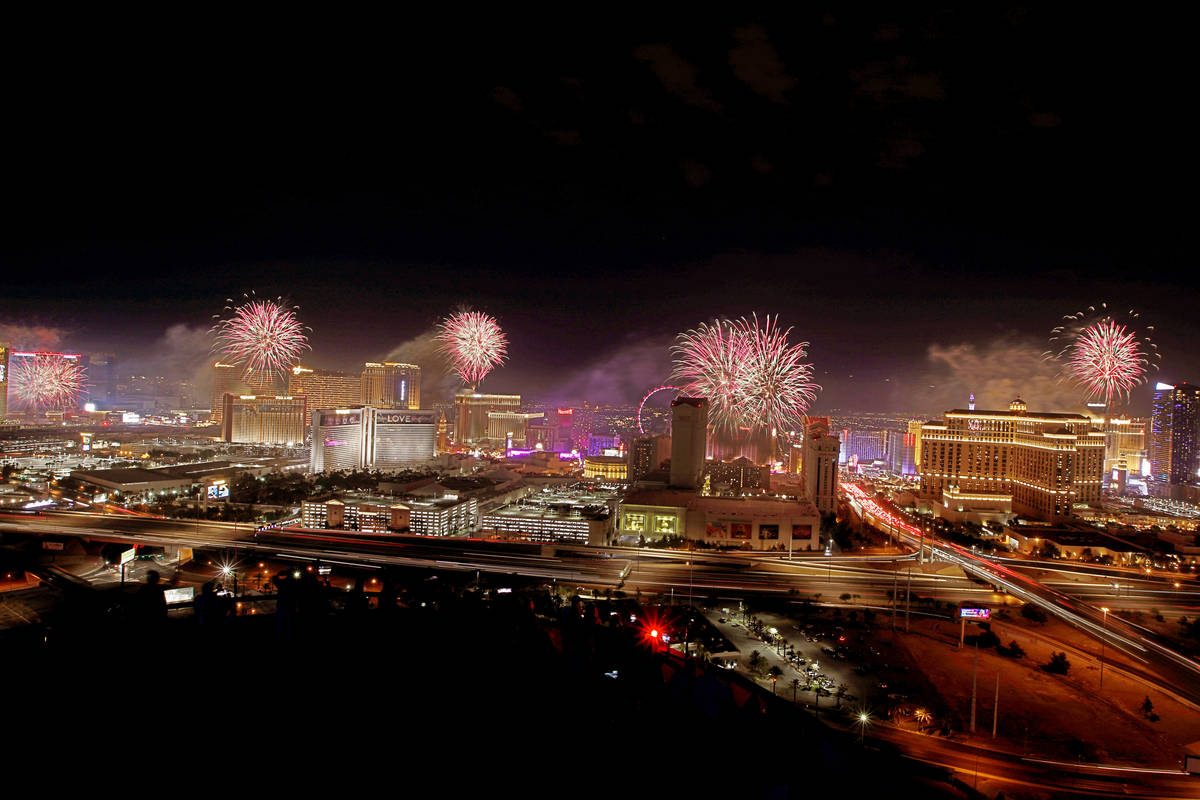 Fireworks explode above the Las Vegas skyline, as seen from the VooDoo Rooftop Nightclub at the ...