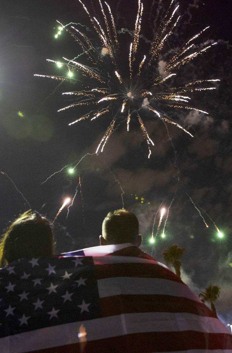 Elaine Fernandez, left, and her husband Ariel, both of Las Vegas, watch as fireworks go off abo ...