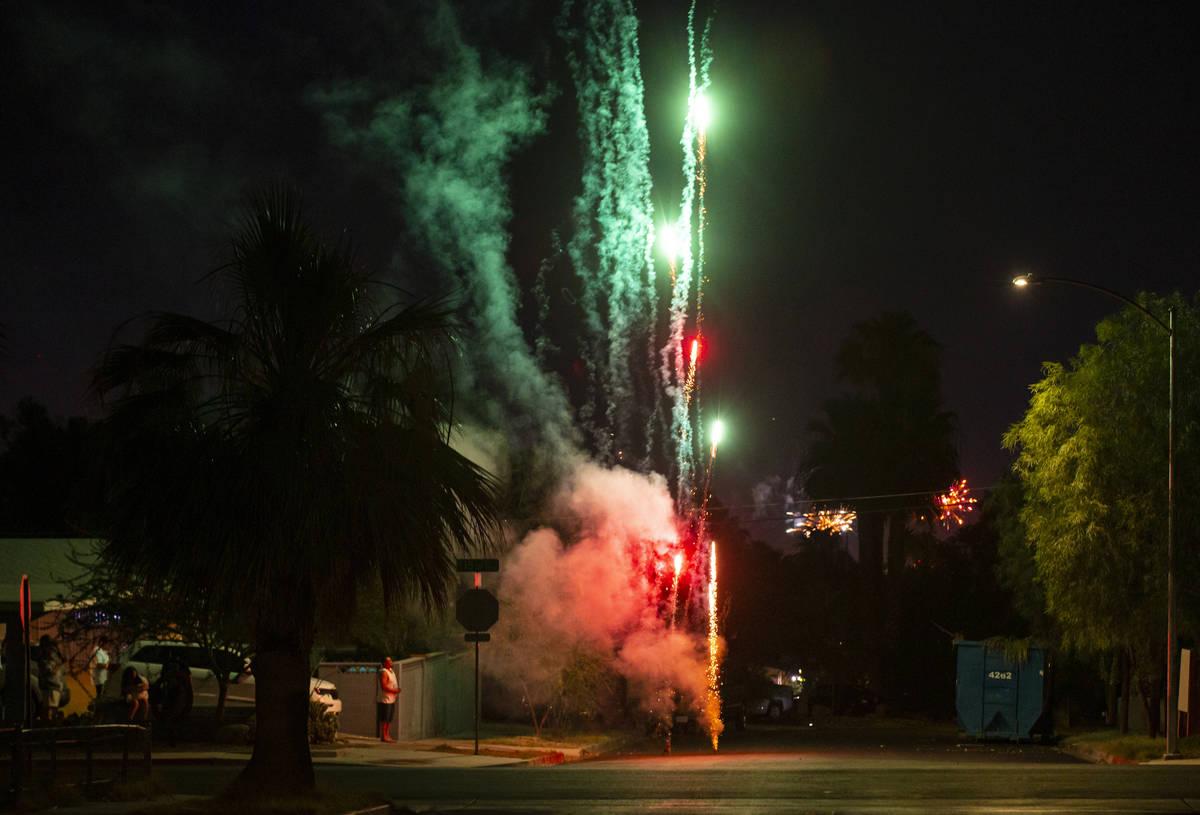 Fireworks go in a neighborhood near downtown Las Vegas in on Sunday, July 4, 2021. (Chase Steve ...