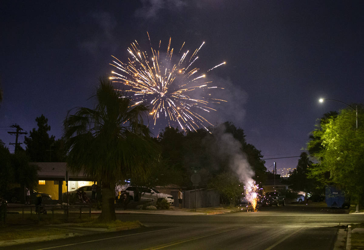 Illegal fireworks go off in a neighborhood near downtown Las Vegas in on Sunday, July 4, 2021. ...