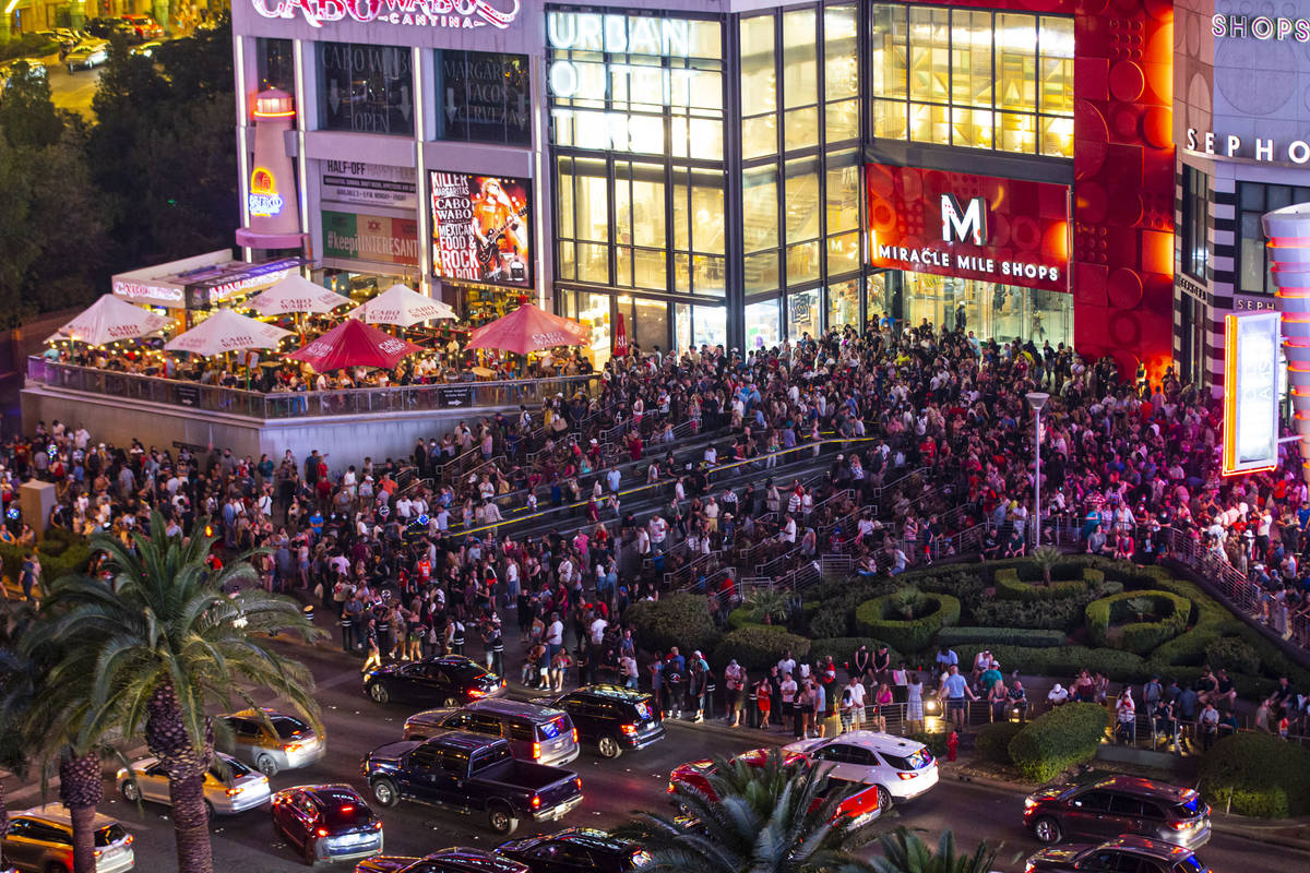 People gather to watch fireworks on the Las Vegas Strip on Sunday, July 4, 2021. (Chase Stevens ...