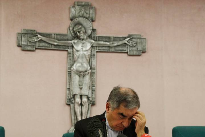 FILE - In this Friday, Sept. 25, 2020 file photo, Cardinal Angelo Becciu looks down as he meets ...