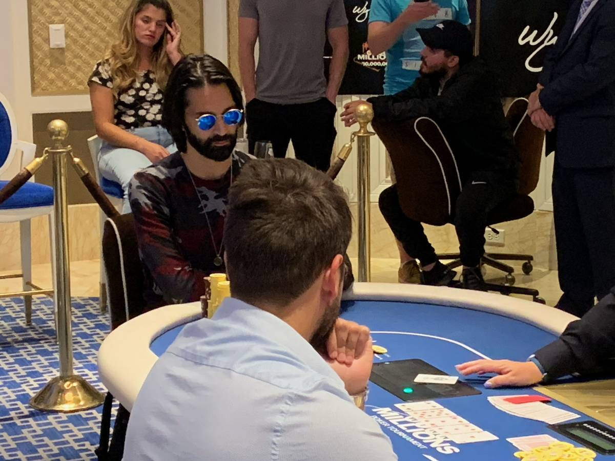 Andrew Moreno, wearning sunglasses, plays at the final table of the Wynn Millions on Saturday, ...