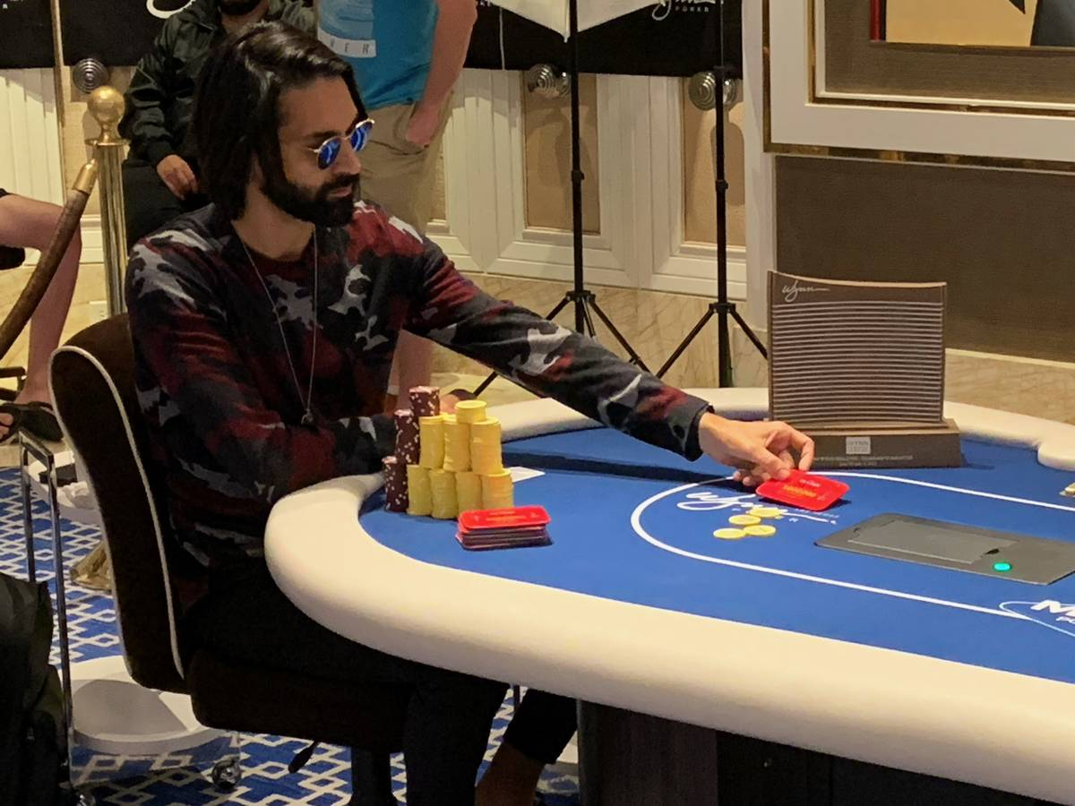 Andrew Moreno plays heads-up with the trophy by his side at the Wynn Millions on Saturday, July ...