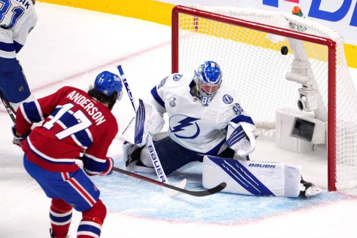 Montreal Canadiens right wing Josh Anderson (17) scores past Tampa Bay Lightning goaltender And ...