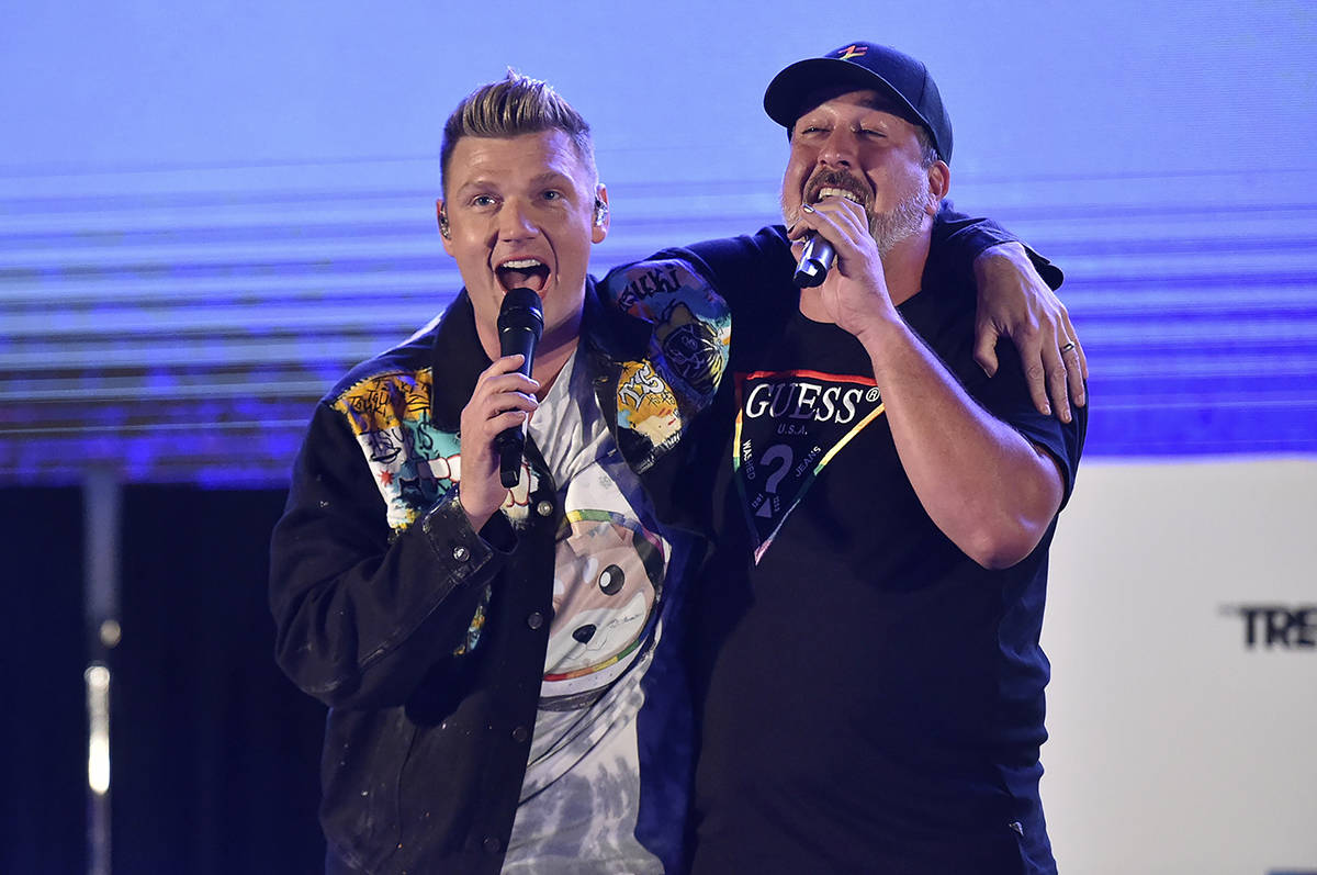 Nick Carter, left, and Joey Fatone perform at Bingo Under the Stars on Friday, June 18, 2021, a ...