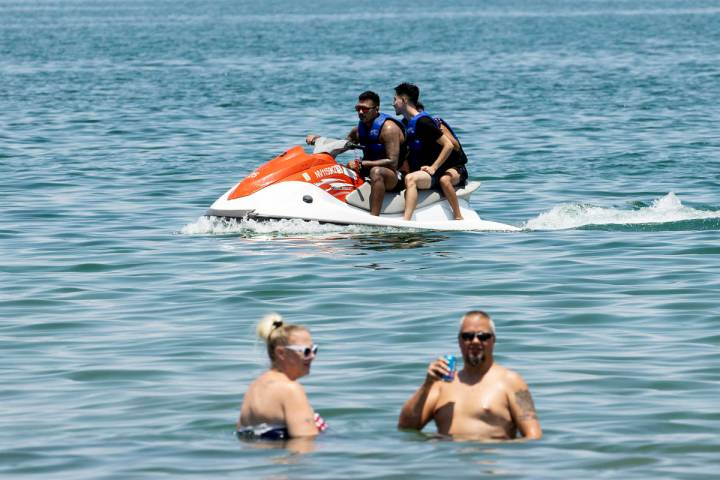 People relax at Boulder Beach in the Lake Mead National Recreation Area, on Friday, July 2, 202 ...