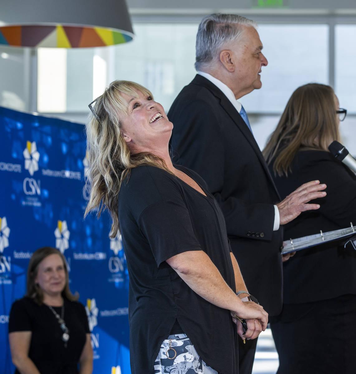Teacher Elizabeth Allder is surprised after winning $250,000 as Governor Steve Sisolak and Immu ...