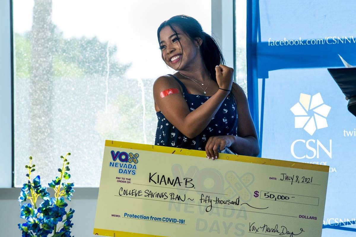 Kiana Butler flexes as she shows off her immunization bandaid after winning $50,000 in a colleg ...
