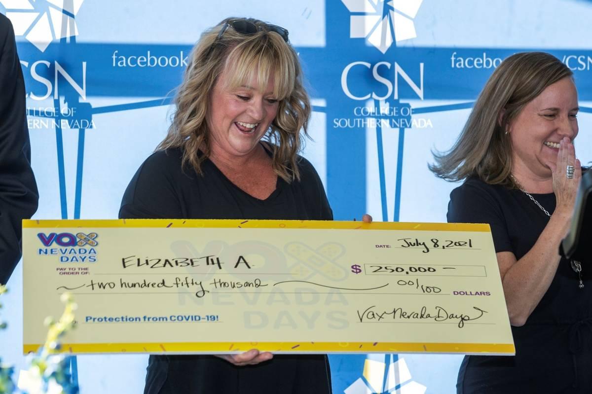 Teacher Elizabeth Allder looks to her $250,000 check as Governor Steve Sisolak and Immunize Nev ...