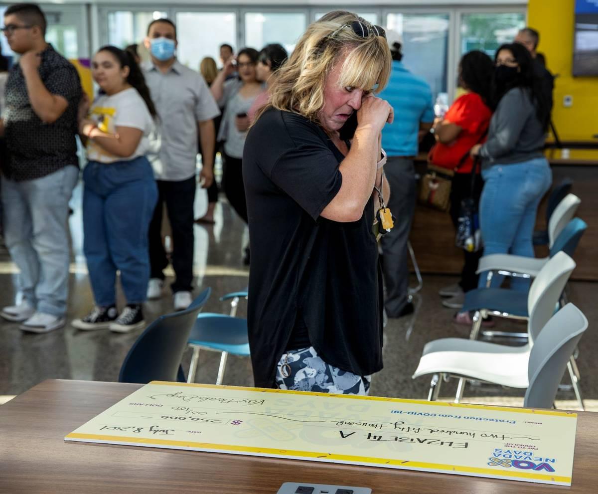 Teacher Elizabeth Allder cries while calling her husband after winning $250,000 as Governor Ste ...