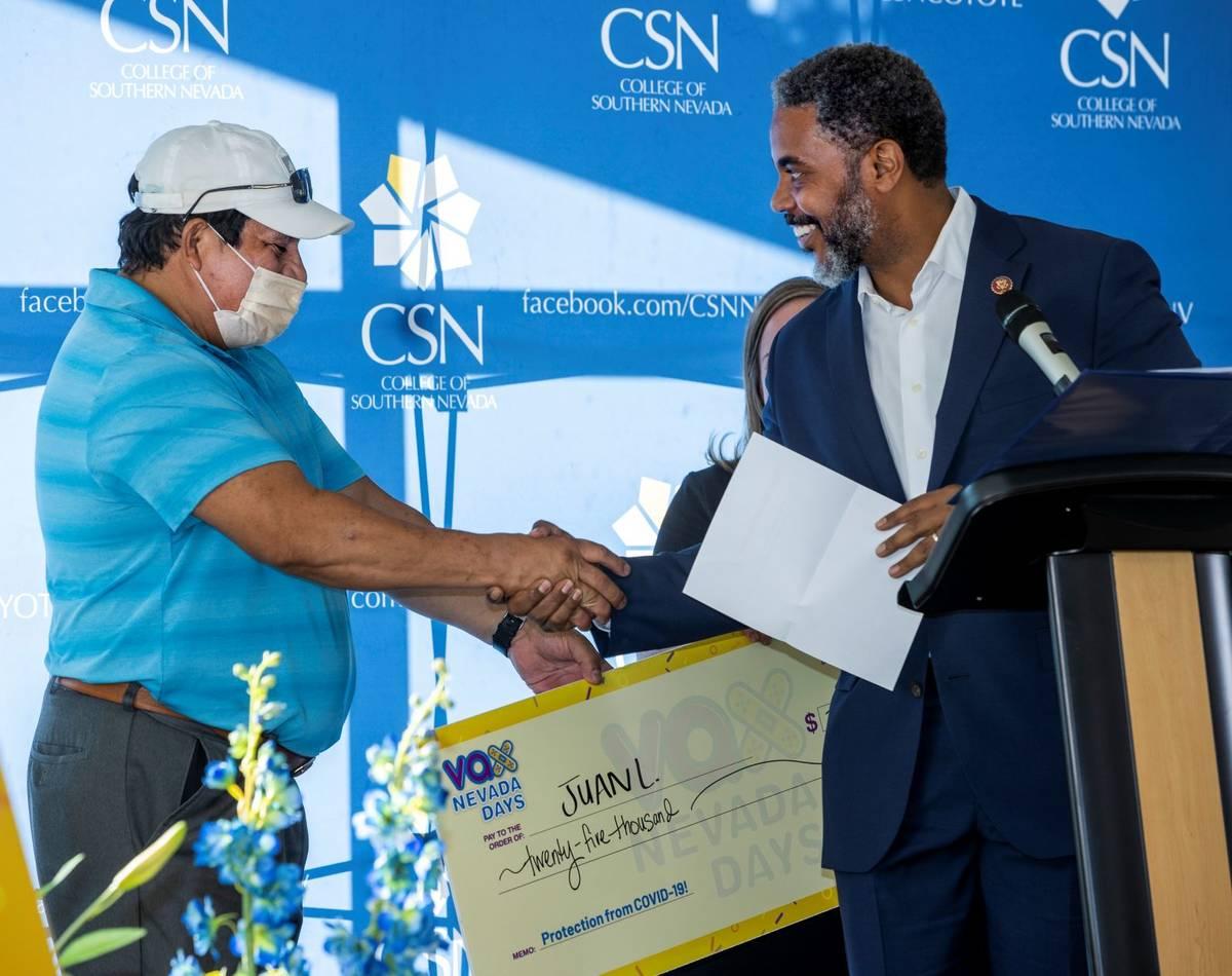 Juan Lemus is congratulated by Congressman Steven Horsford after winning $25,000 as Governor St ...