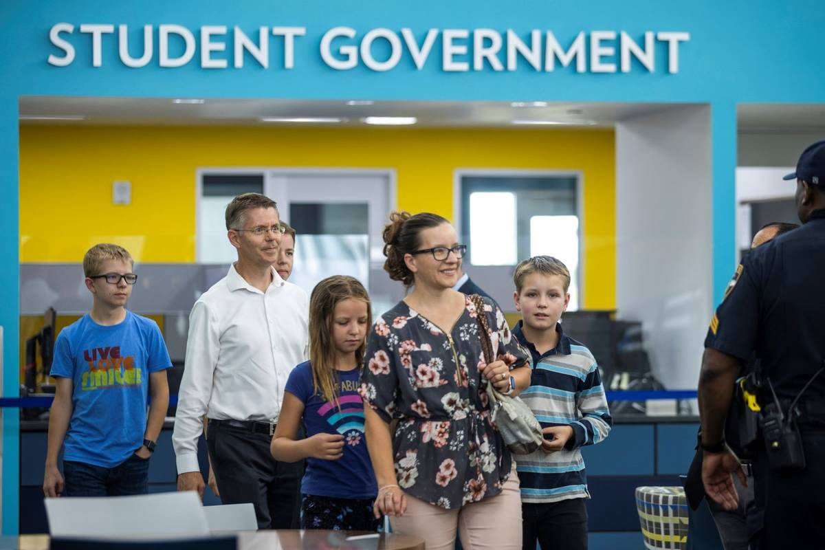 Student winner Zachary S. (Right) arrives with his family as Governor Steve Sisolak and Immuniz ...