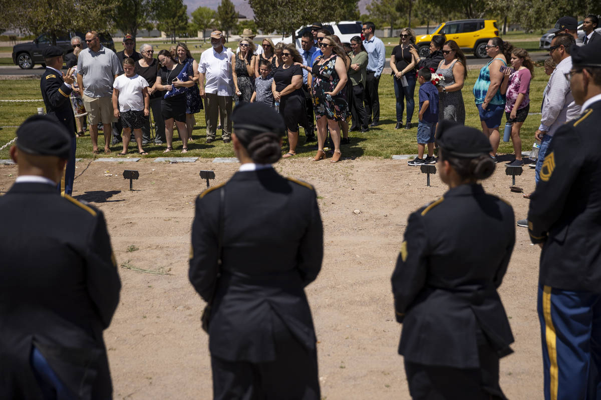 Friends and family attend the funeral service for retired Nevada National Guard member and Metr ...