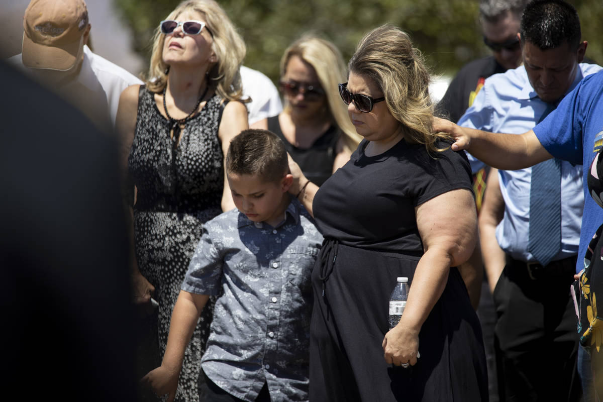 Christa Swanger, right, and her son Noah, 8, attend the funeral service for her husband, retire ...