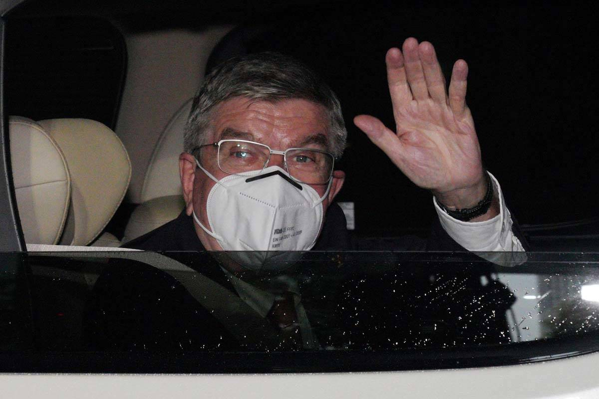 International Olympic Committee (IOC) President Thomas Bach waves from the vehicle to media upo ...