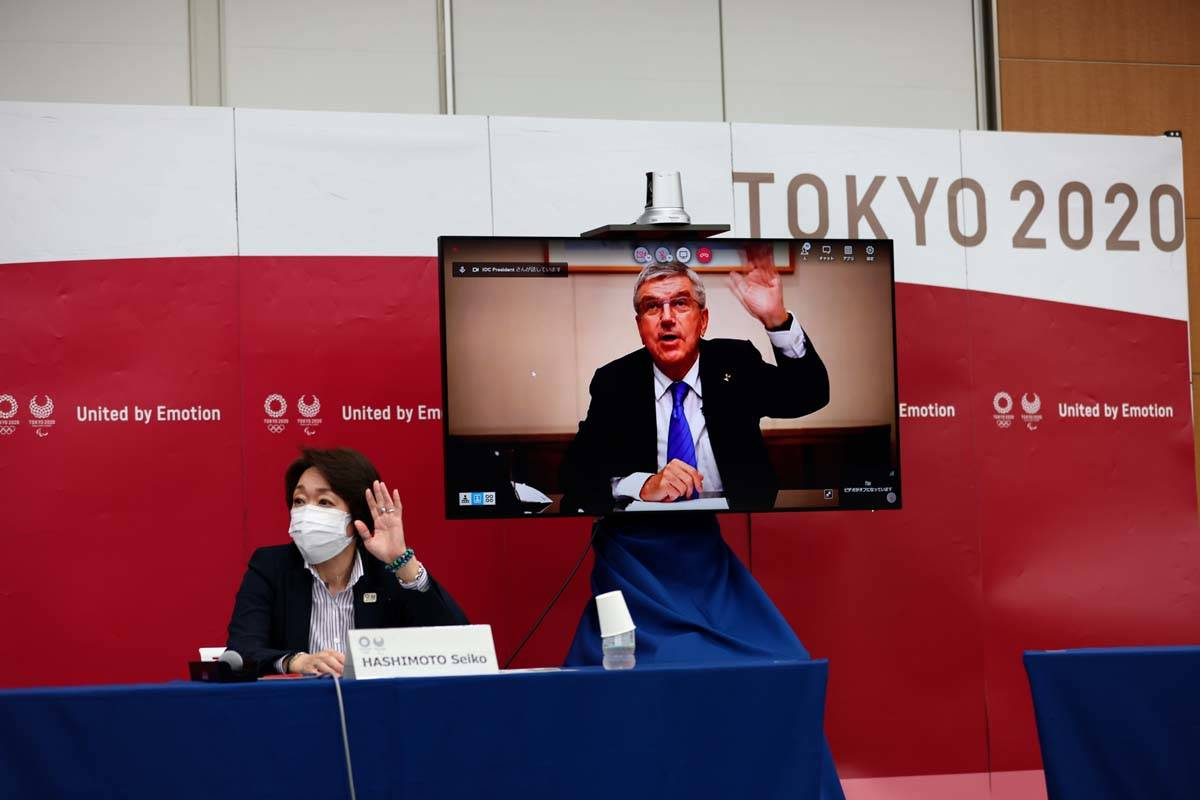 International Olympic Committee (IOC) president Thomas Bach (on-screen) and Tokyo 2020 presiden ...
