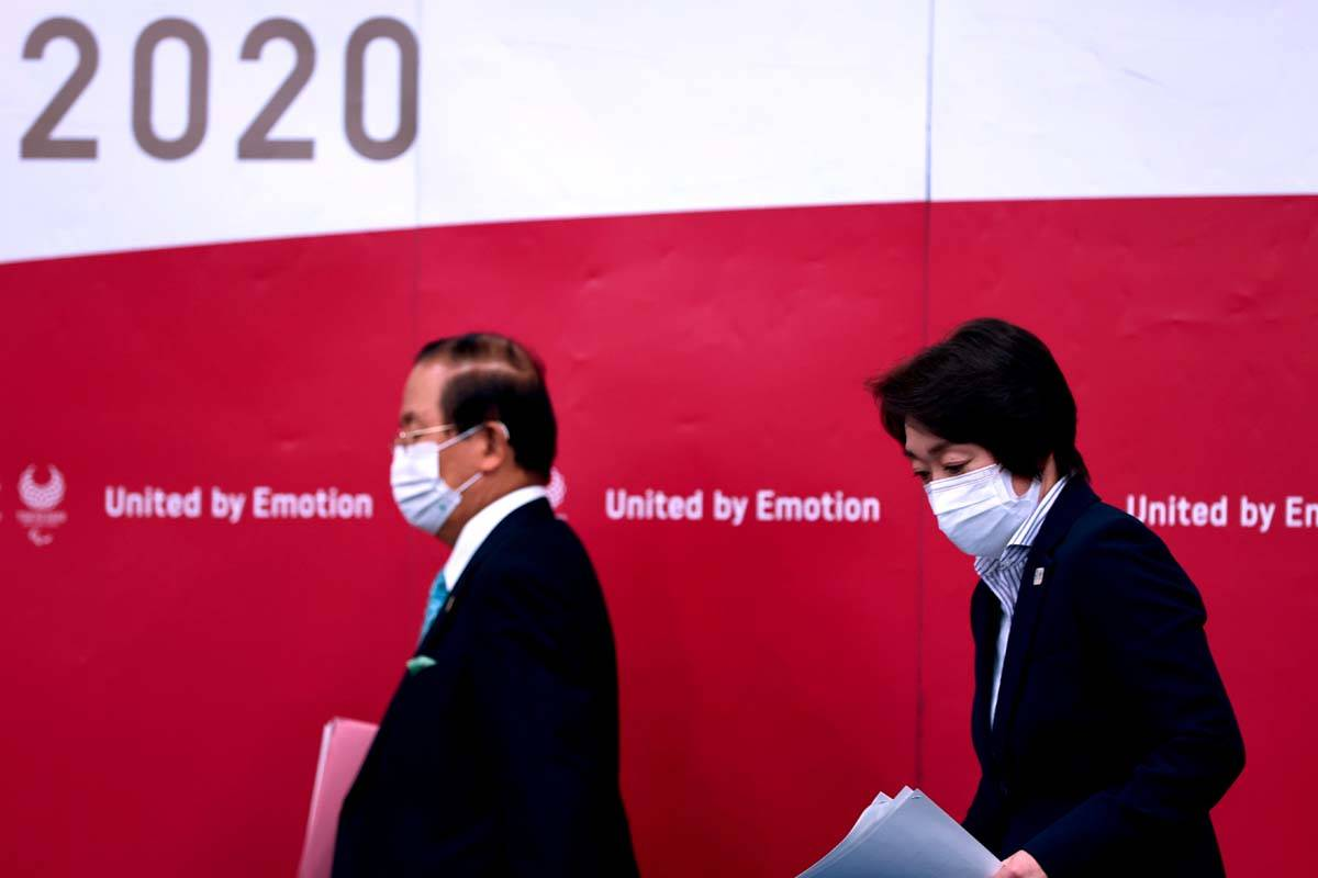 Tokyo 2020 president Seiko Hashimoto, right, and CEO Toshiro Muto attend a press conference, in ...