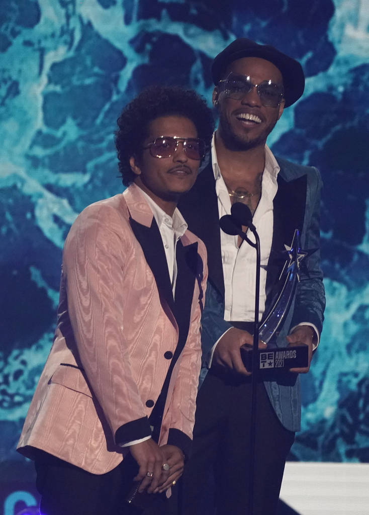 Bruno Mars, left, and Anderson .Paak, of Silk Sonic, accept the best group award at the BET Awa ...