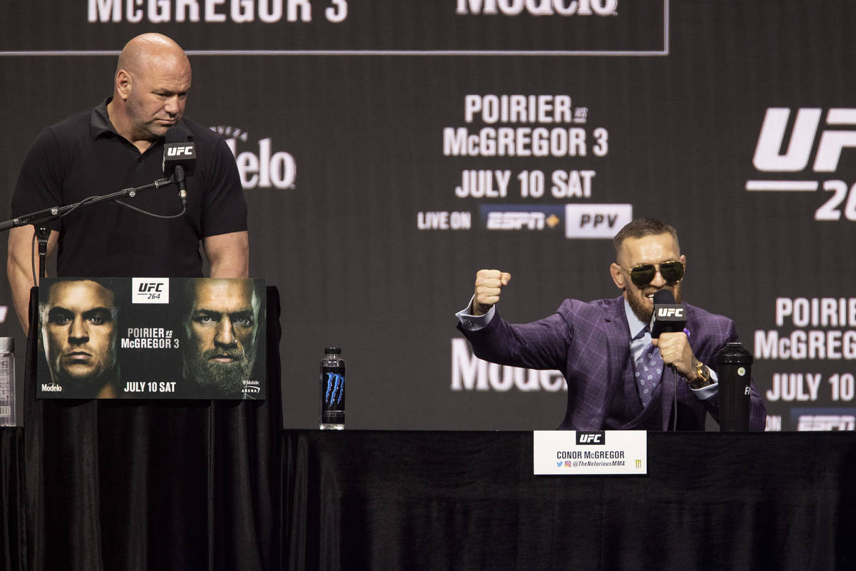 Conor McGregor, right, speaks as UFC president Dana White looks on during an UFC 264 press conf ...