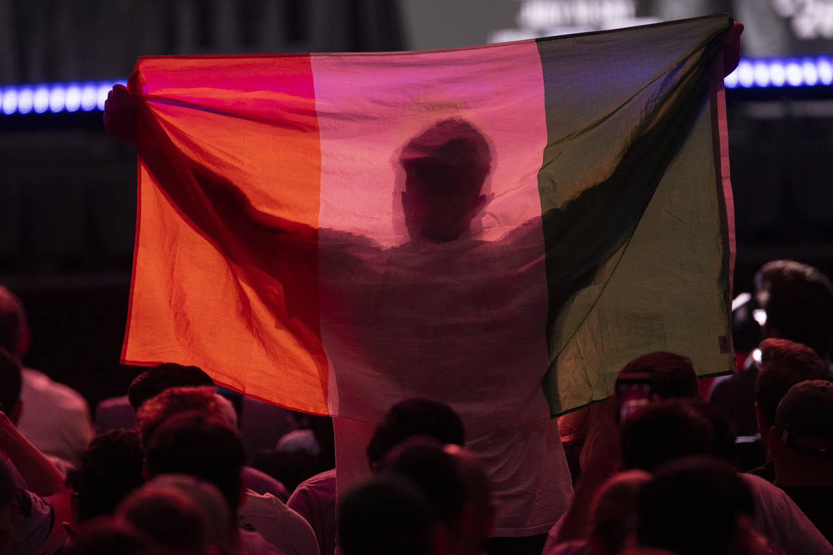 A fan raises an Ireland flag during an UFC 264 press conference at T-Mobile Arena in Las Vegas, ...