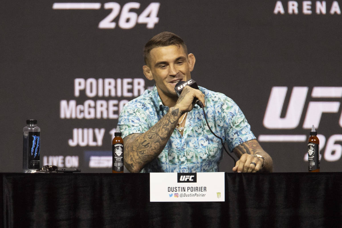 Dustin Poirier speaks during an UFC 264 press conference with Conor McGregor, right, and UFC pr ...