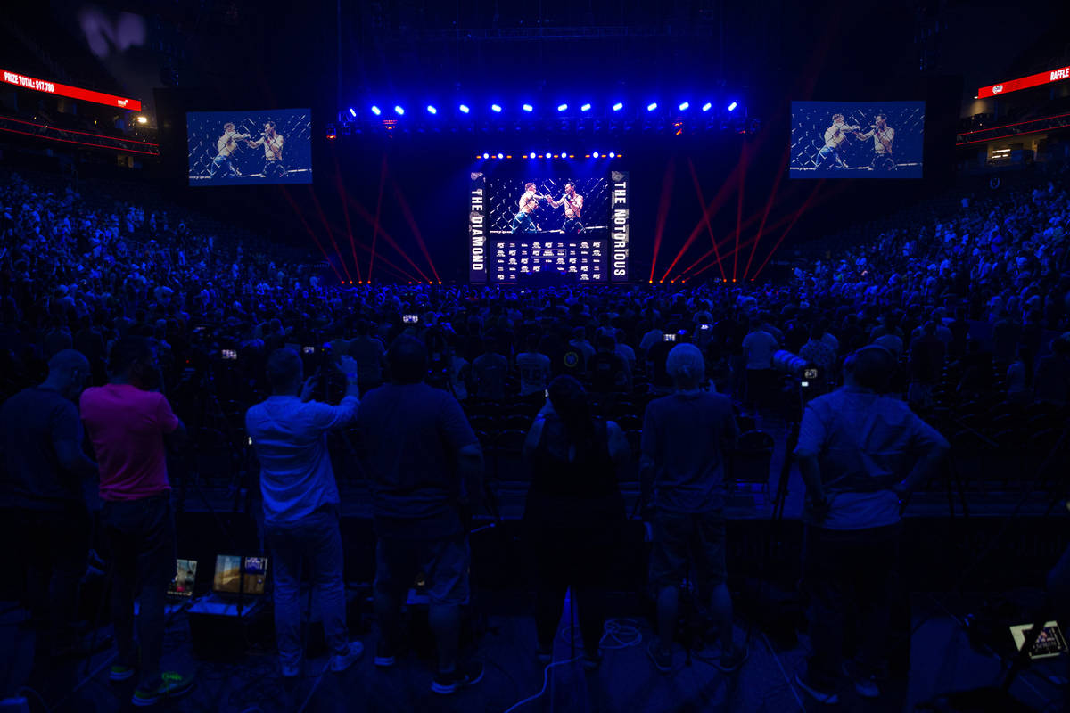 People attend the UFC 264 press conference at T-Mobile Arena in Las Vegas, Thursday, July 8, 20 ...