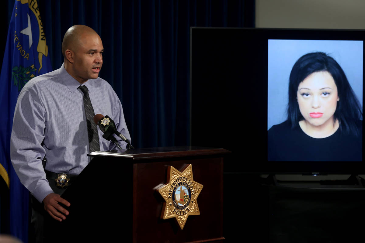 Las Vegas police homicide Lt. Ray Spencer shows a photo during a news conference at Metropolita ...