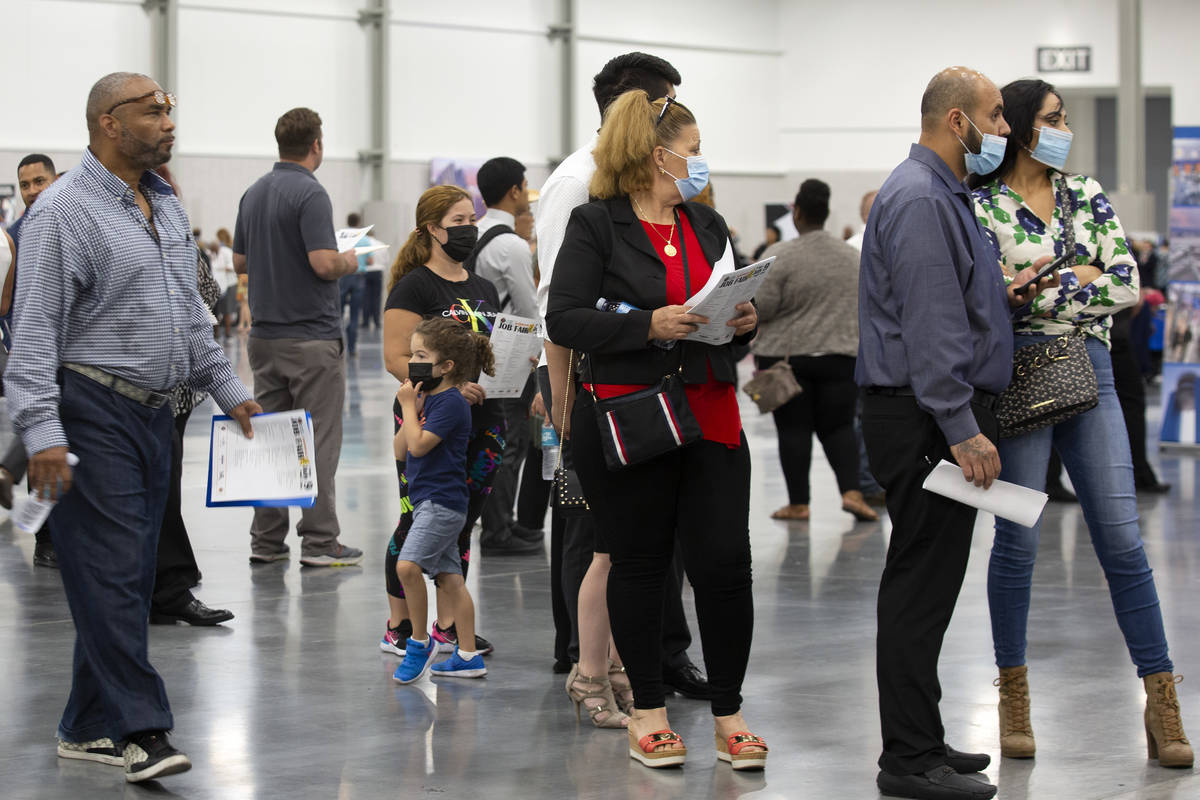 Job-seekers wait in line for the MGM Resorts International booth at a summer job fair hosted by ...