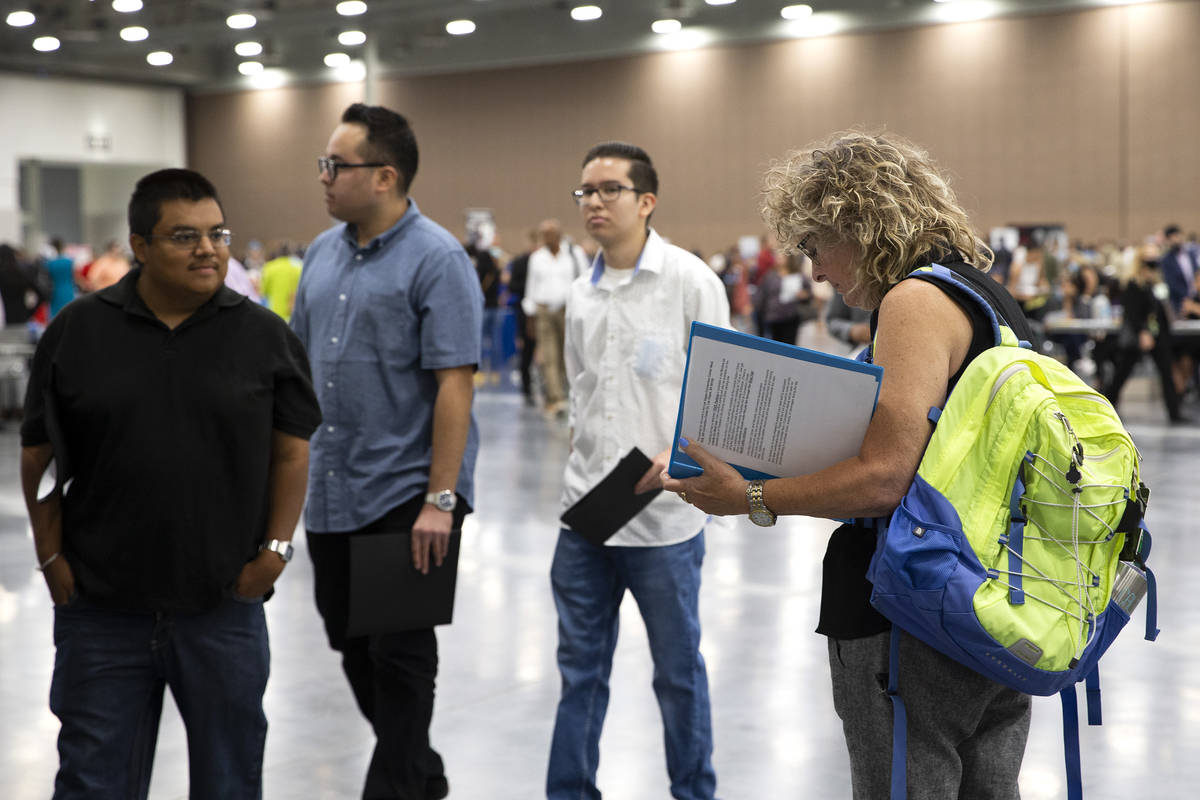 Joan Pashley-Baynes, right, reviews her resume during a summer job fair hosted by Clark County ...